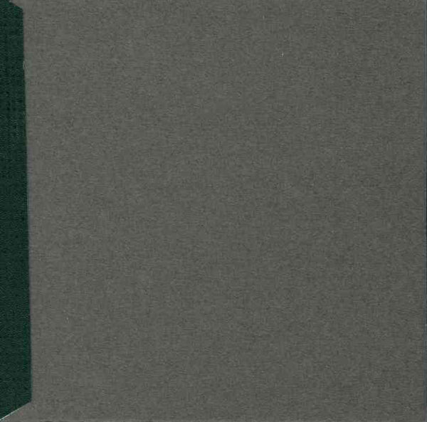 dark grey card cover with a green/black piece of tape running along the left hand side.