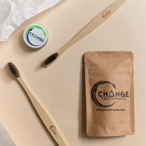 Change toothpaste cinnamon 1 month pack, travel tin, and 2 toothbrushes