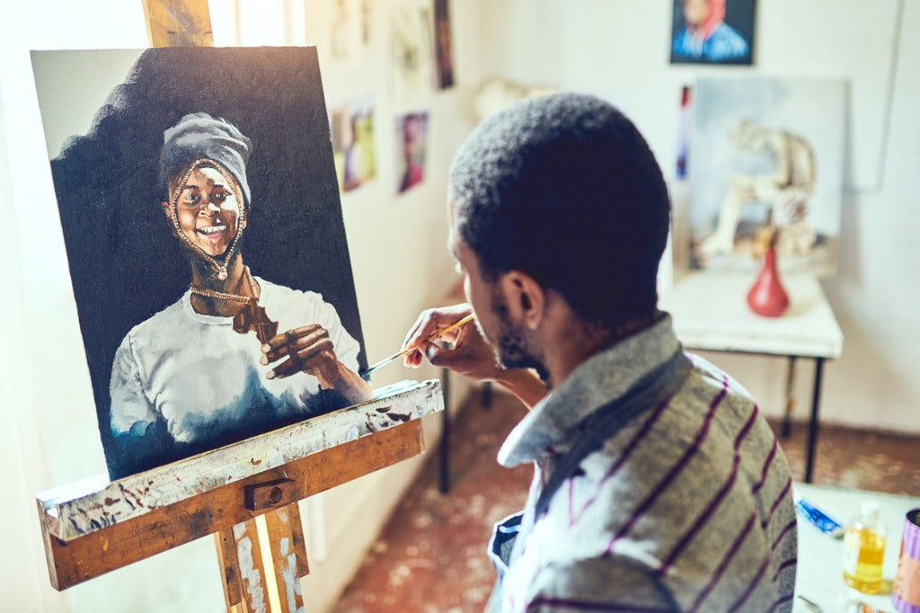 man-painting-on-easel