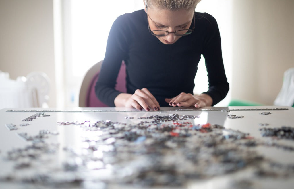 woman-doing-a-jigsaw-puzzle