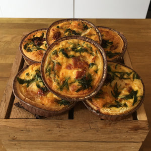 Goats cheese, confit, and wild rocket quiche