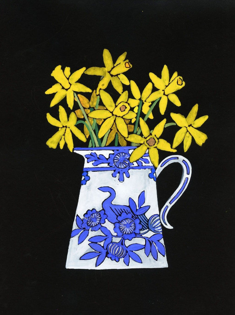 yellow daffodils in a blue and white vase