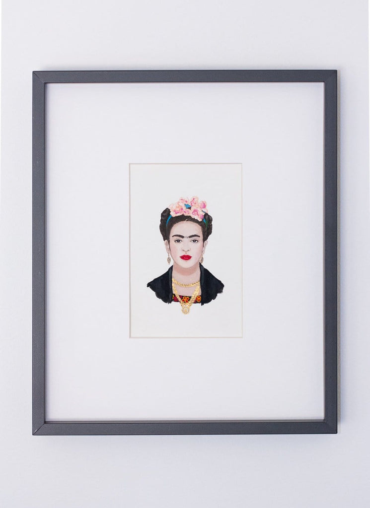 Frida Kahlo portrait in gouache by Liz Langley framed in black frame