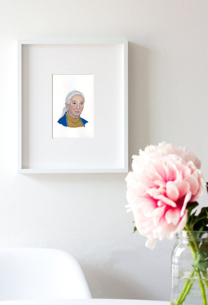 Jane Goodall portrait in gouache by Liz Langley framed in white frame
