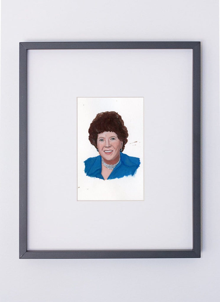 Julia Child portrait in gouache by Liz Langley framed in black frame