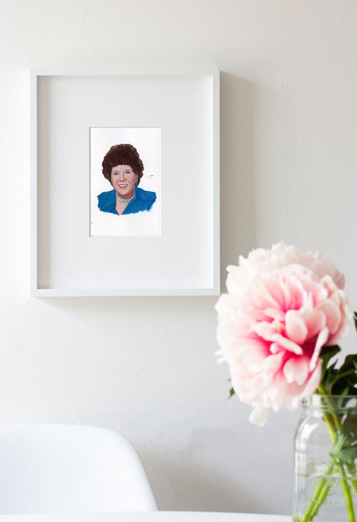 Julia Child portrait in gouache by Liz Langley framed in white frame