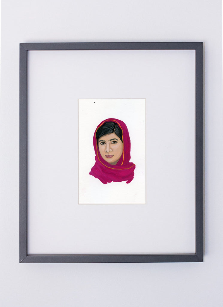 Malala Yousafzai portrait in gouache by Liz Langley framed in black frame