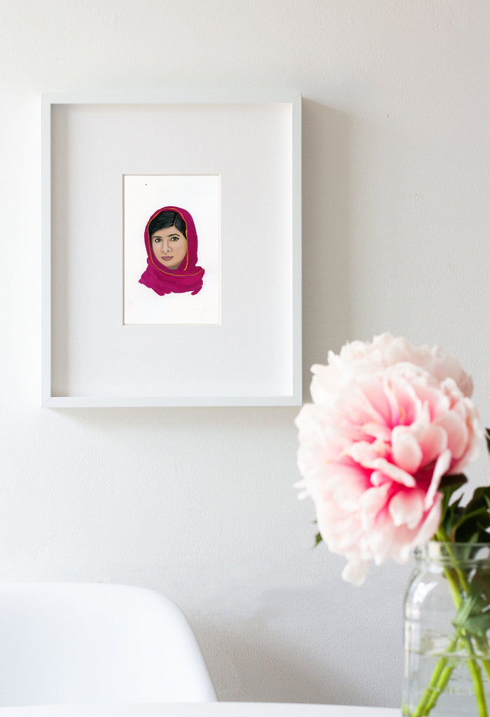 Malala Yousafzai portrait in gouache by Liz Langley framed in white frame