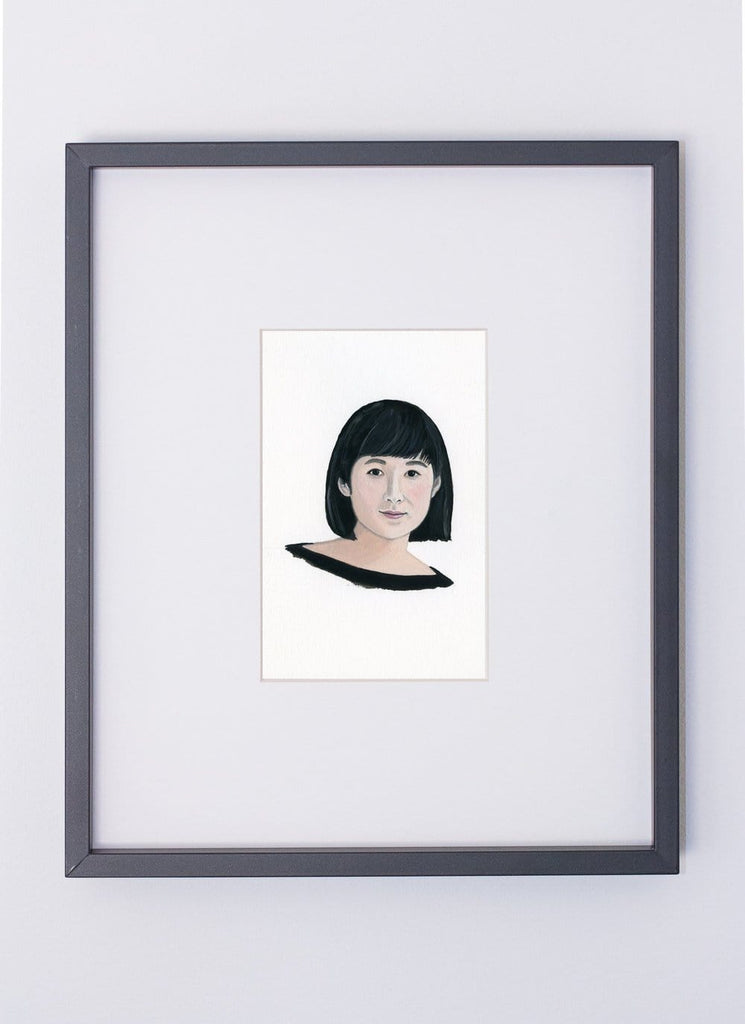 Maya Lin portrait in gouache by Liz Langley framed in black frame