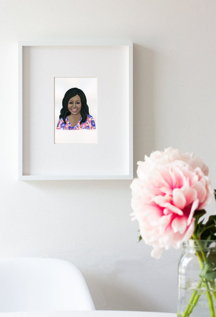 Michelle Obama portrait in gouache by Liz Langley framed in white frame