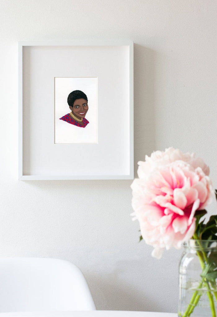 Miriam Makeba portrait in gouache by Liz Langley framed in white frame