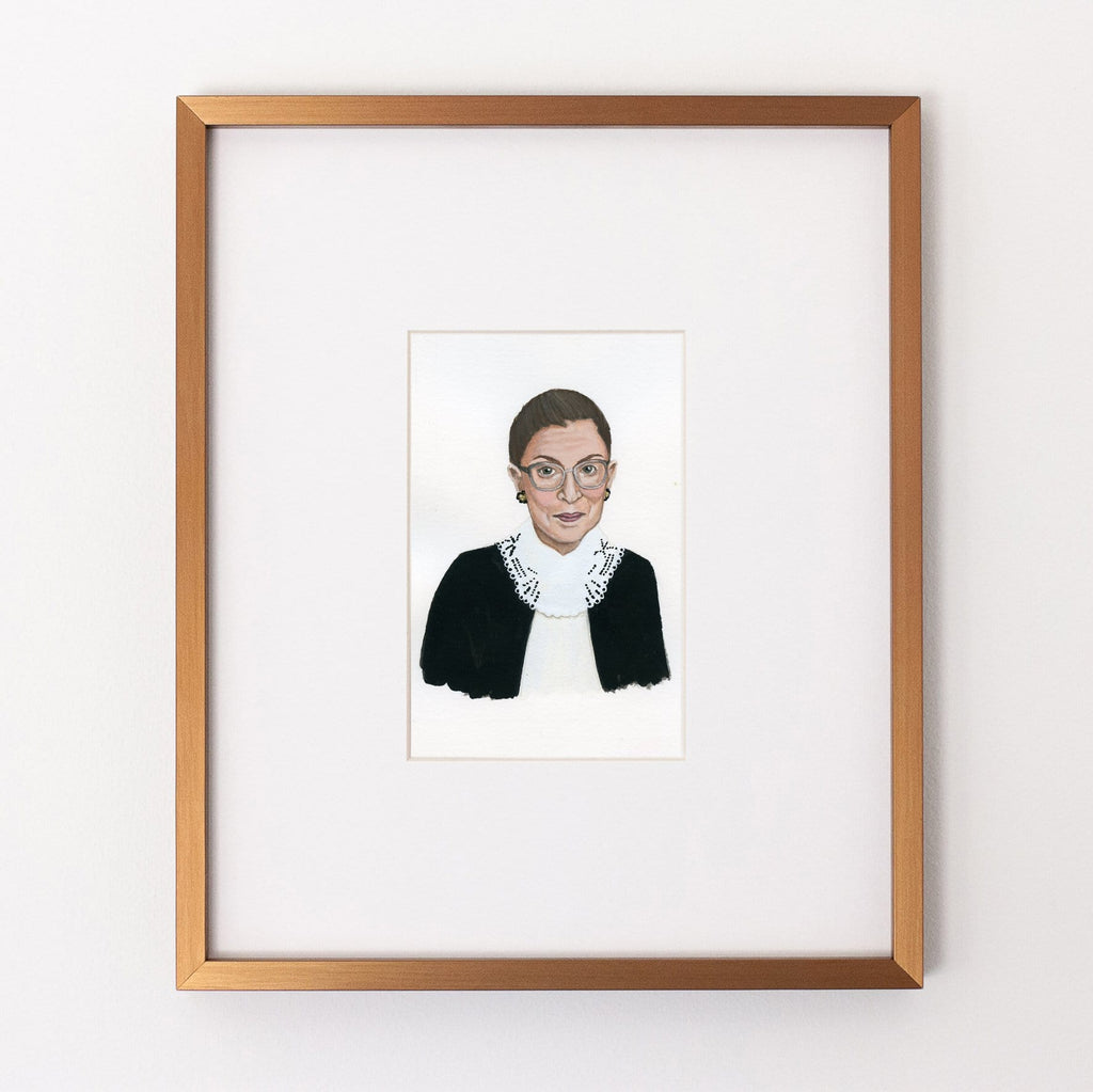 Ruth Bader Ginsberg portrait in gouache by Liz Langley framed in antique gold frame