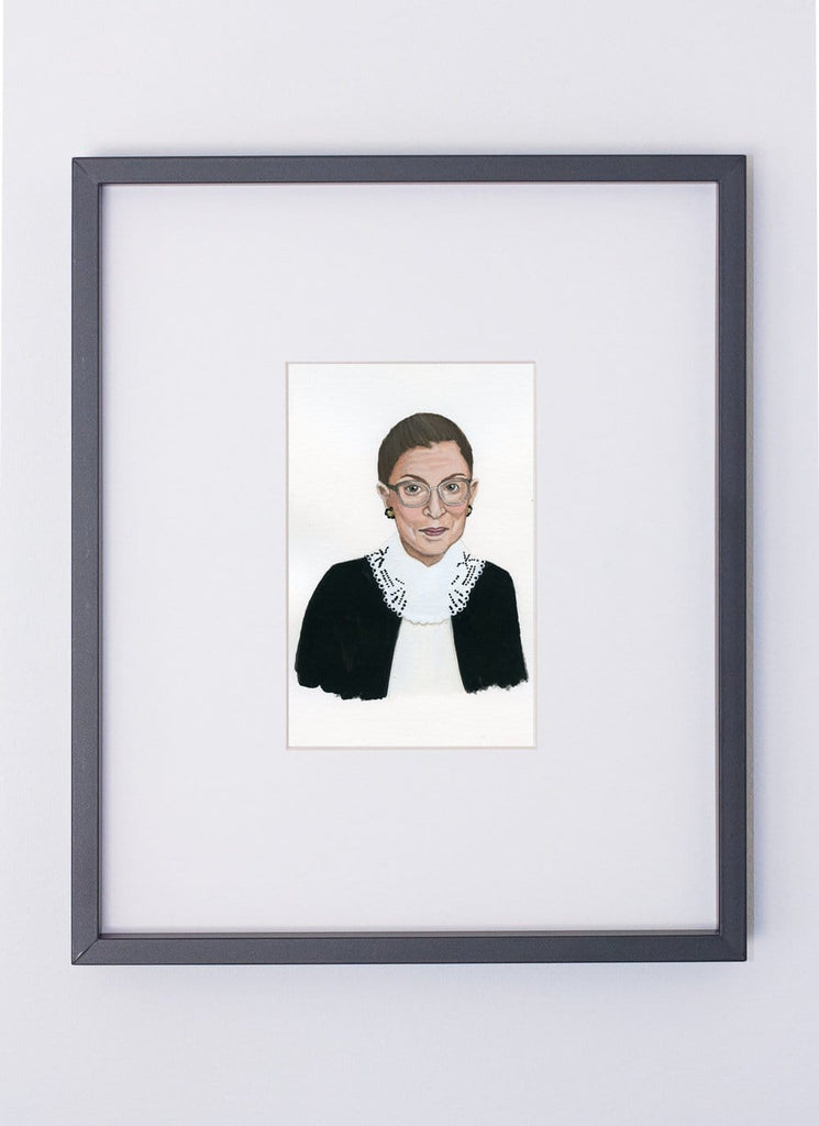 Ruth Bader Ginsberg portrait in gouache by Liz Langley framed in black frame