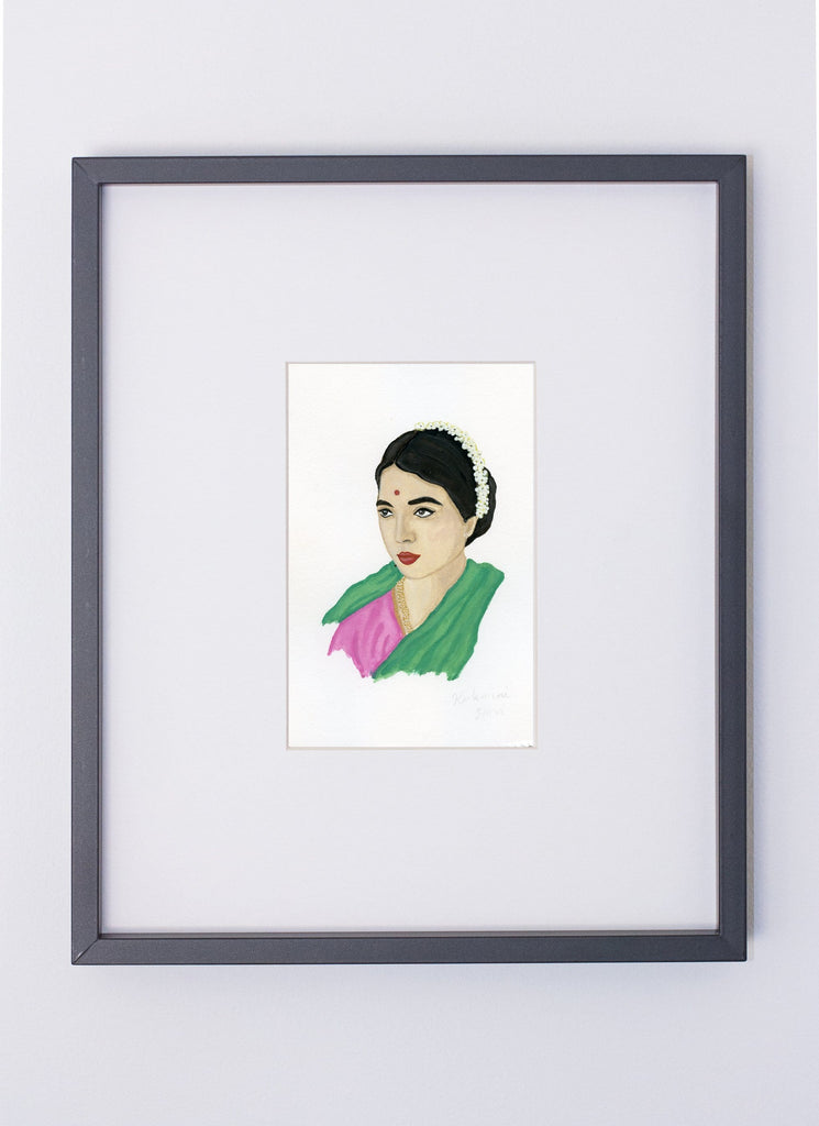 Rukmini Devi portrait in gouache by Liz Langley framed in black frame