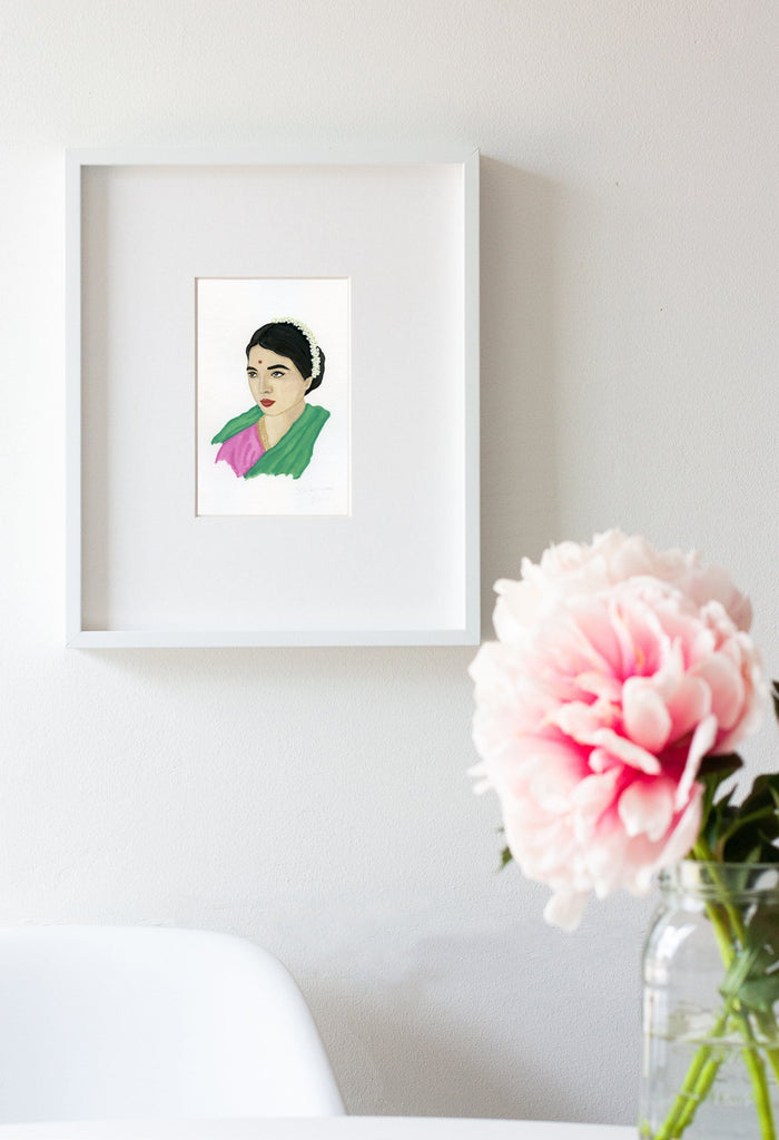 Rukmini Devi portrait in gouache by Liz Langley framed in white frame