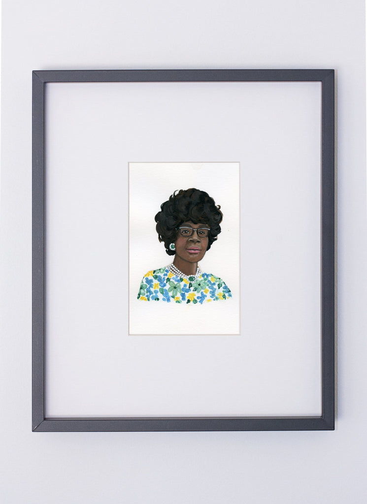 Shirley Chisholm portrait in gouache by Liz Langley framed in black frame