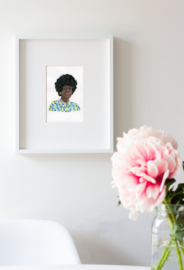Shirley Chisholm portrait in gouache by Liz Langley framed in white frame