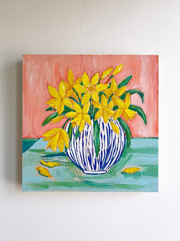 12x12 inch acrylic painting of a bouquet of daffodils bursting from a blue and white striped vase, on a coral and aqua background by Liz Langley.