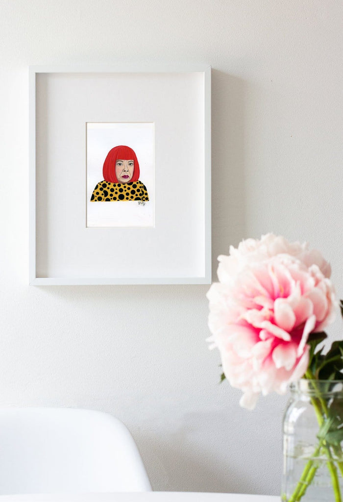 Yayoi Kusama portrait in gouache by Liz Langley framed in white frame