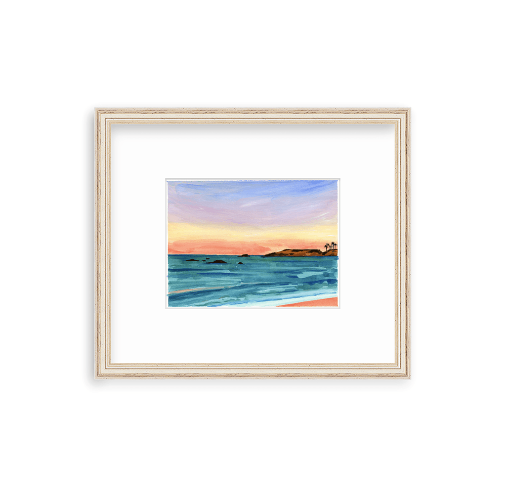 6x8 inch gouache seascape painting on paper captures the sunset sky and seaviews at Punta Mita in Mexico. Deep blue, purple, golden yellow and coral sweep across the sky, and the sea is deep aqua, turquoise and blue, with coral highlights on the water and beach. A few rocky outcroppings dot the ocean, along with a cluster of palms on the distant peninsula. It is matted in an off white and distressed gold frame by framebridge.