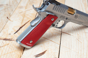 Red 1911 grips on a pistol