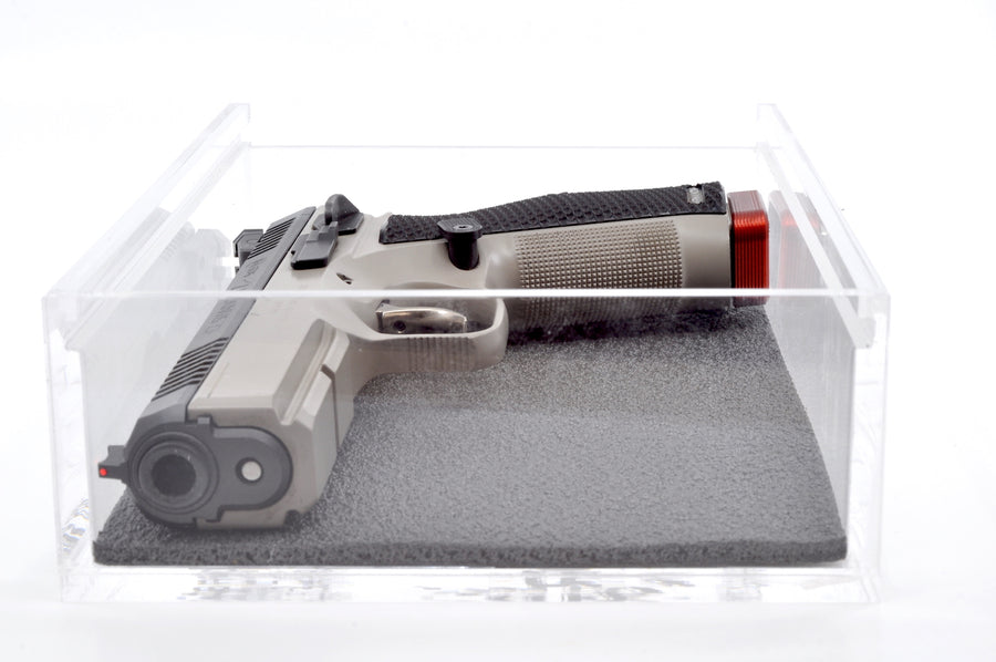 CZ pistol in IPSC box equipped with a base pad
