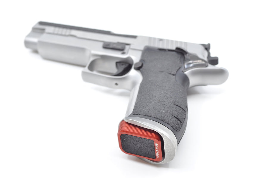 Red Armanov Base Pad on a Sig Sauer Pistol