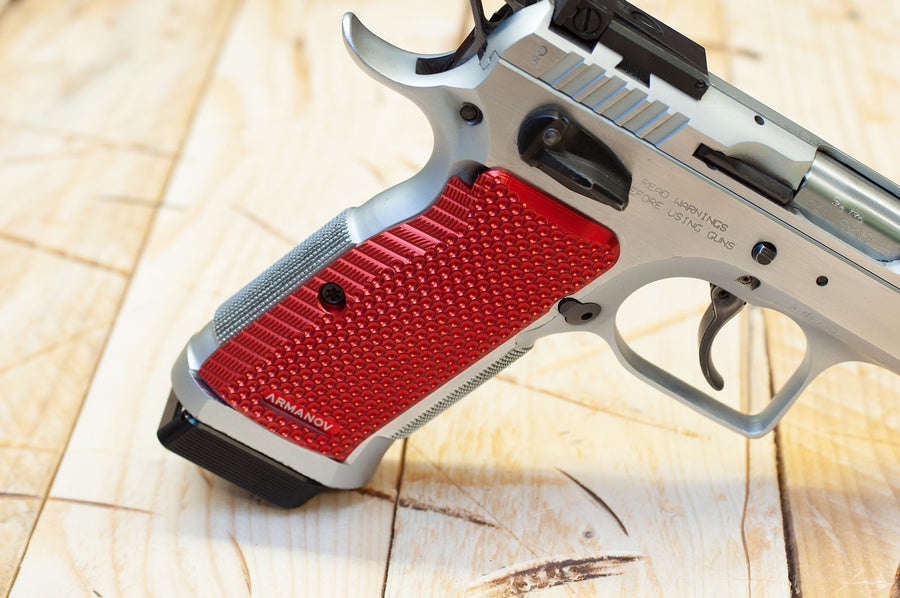 Red Tanfoglio grips on a pistol