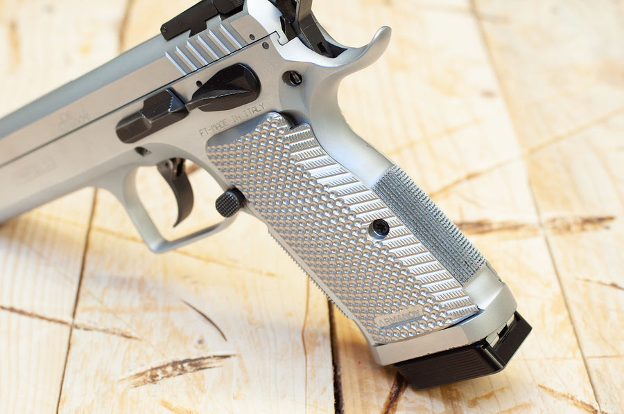 Silver Tanfoglio grips on a pistol