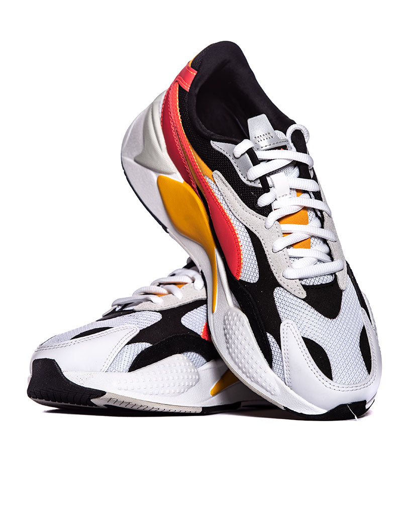 PUM RS X PUZZLE SNEAKERS IN BLACK AND ORANGE