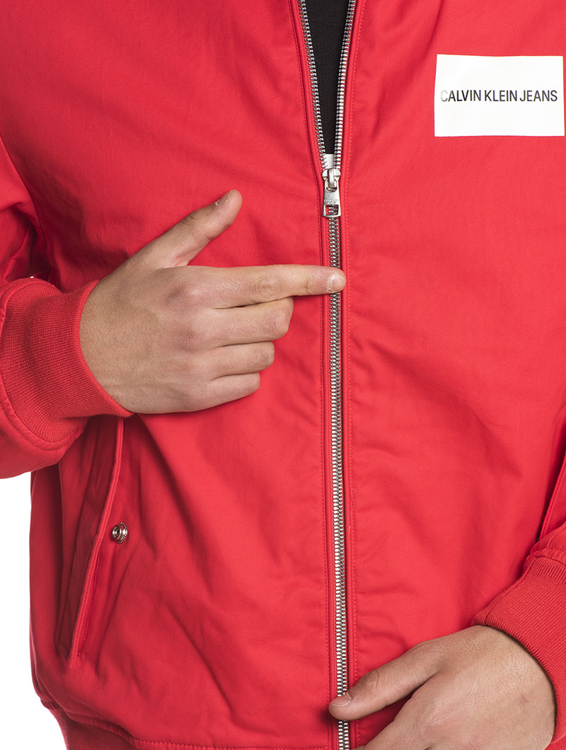 INSTITUTIONAL BOMBER JACKET IN TOMATO RED