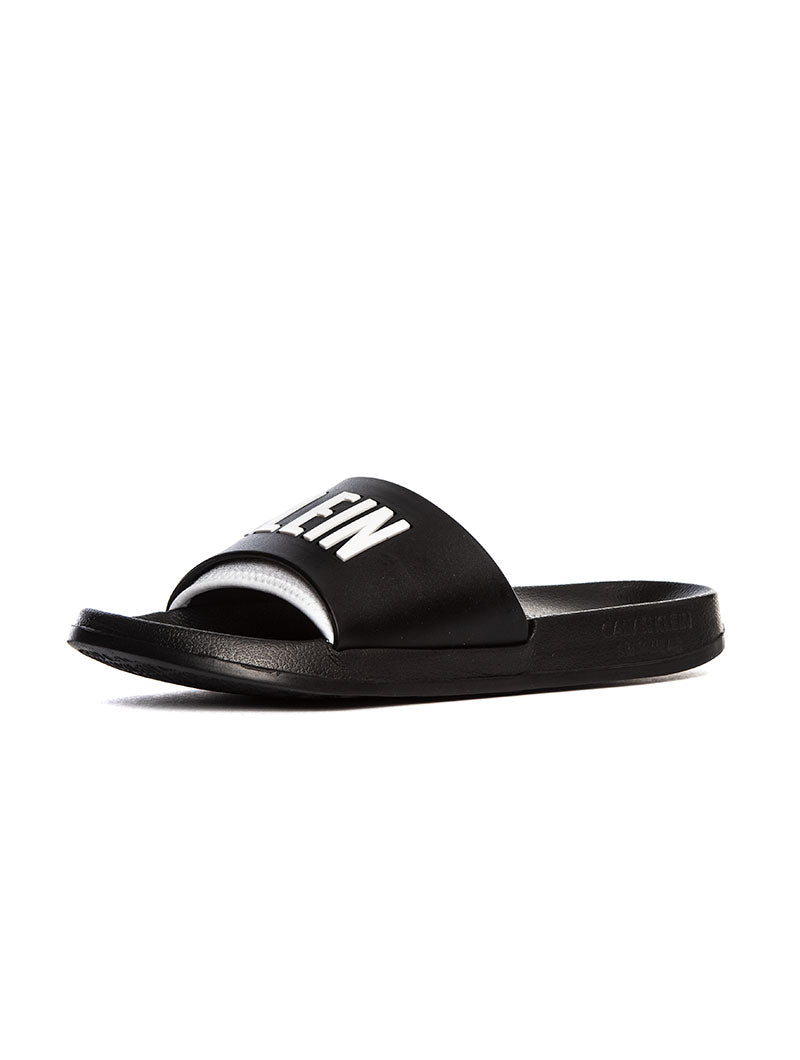 CK SLIDE SANDALS IN BLACK