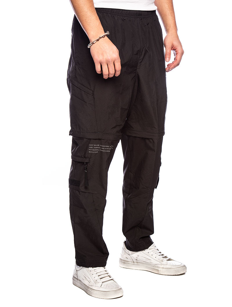 FIRST MILE 2IN1 WOVEN SWEATPANTS IN BLACK