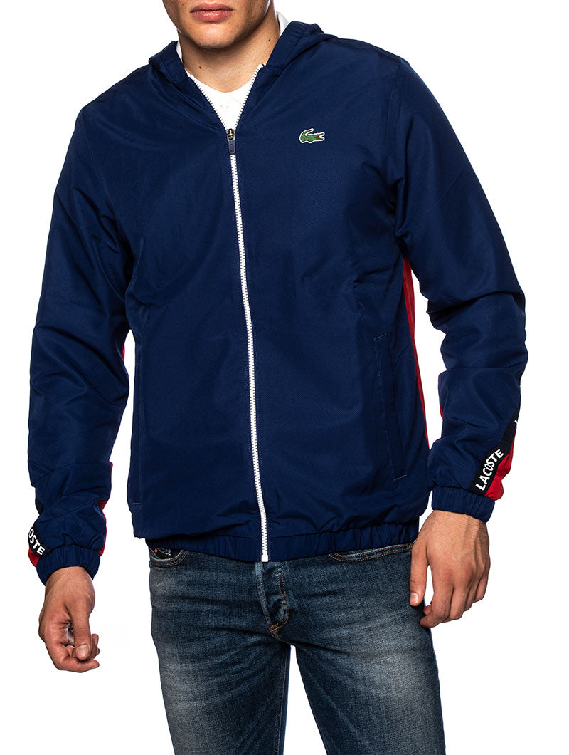 LACOSTE TRACK JACKET IN BLUE AND RED