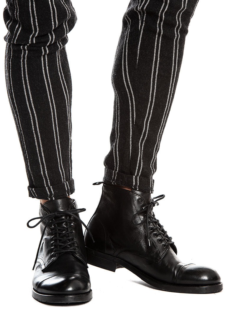 SPIKE STRIPED PANTS IN BLACK AND WHITE
