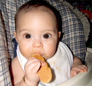 baby eating GMO food