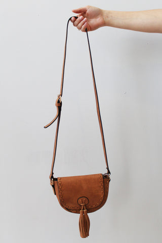 cogna or camel colored crossbody handbag with tassel