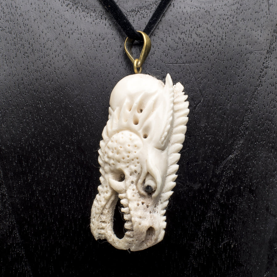 Carved Bone Dragon Head Pendant