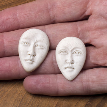 Pair of Bone Cabochon Faces