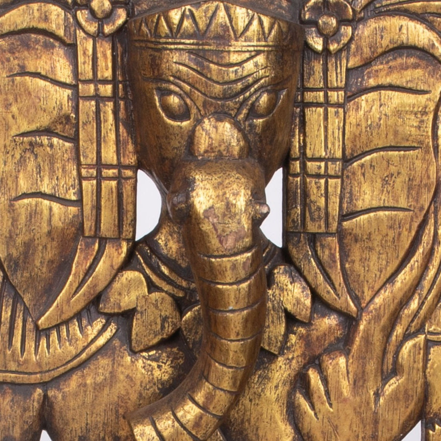 Golden Ganesha Standing Tall on the Wall