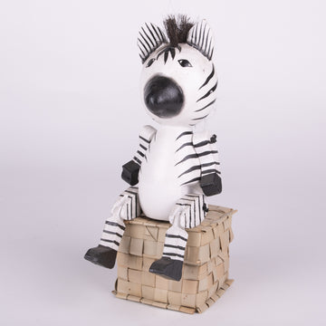 There is a Zebra sitting on Your Shelf