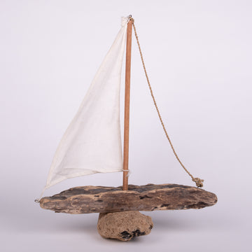 Sailing By on a Driftwood Boat