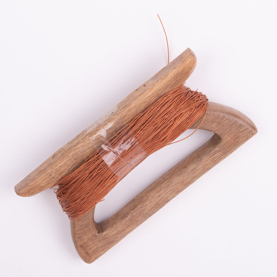 Handcrafted kite string holder