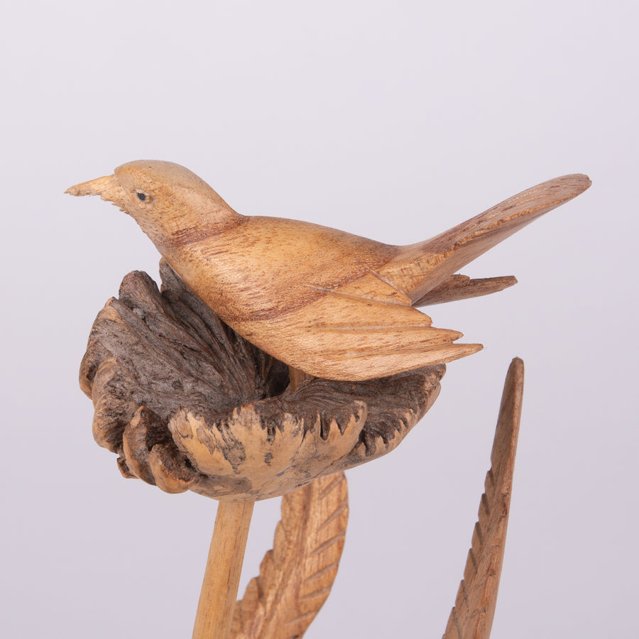 Parasite Carvings of Delicate Birds and Leaves