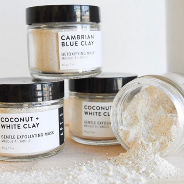 glass jar filled with coconut + white clay face mask a gentle cleansing and exfoliating mask