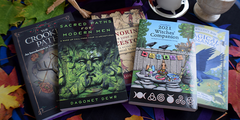 Image contains five books on witchcraft