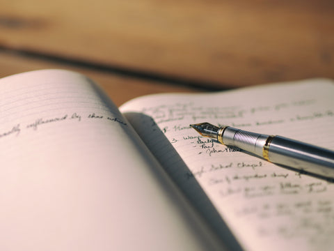 Image of a journal with a fountain pen