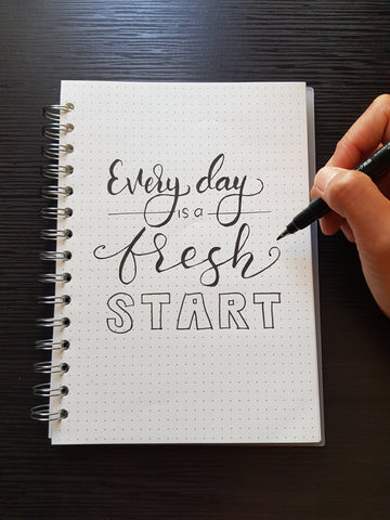 """journal page with """"everyday is a fresh start"""" written on it"""