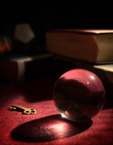 image of a clear crystal sphere and a key