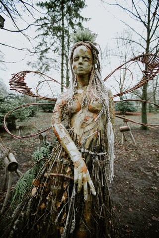 Image of an outdoor, natural elements fairy statue